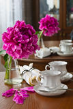 White cup of tea and peony flower Royalty Free Stock Photography