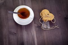 The White cup of tea and saucer on a brown wooden table. Copy space. White cup of tea and saucer on a brown wooden table. Copy space Stock Images