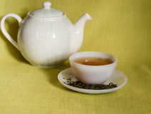 White cup of tea and teapot Royalty Free Stock Images