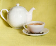 White cup of tea and teapot Stock Photography
