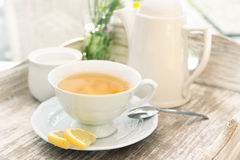White cup of tea on vintage table composition Royalty Free Stock Image