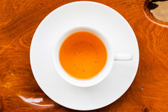 White cup of tea on wood table. White cup of fresh tea on wood table, view from above royalty free stock images