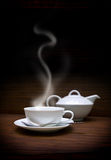 White cup and teapot Stock Photo