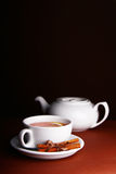 White cup and teapot on a brown background Royalty Free Stock Photo
