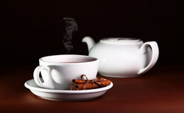 White cup and teapot on a brown background Royalty Free Stock Photos
