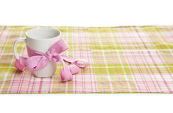 White cup tied with a ribbon Stock Image