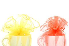 White cup was wrapped red and yellow fabric Royalty Free Stock Images