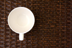 White cup on weave wood table Stock Image