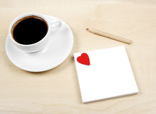 White cup and white love page Royalty Free Stock Photos