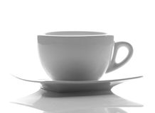 White cup on white saucer Stock Photo