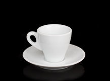White cup and white saucer with reflection Stock Photography