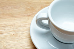 White cup on wood closeup Royalty Free Stock Images