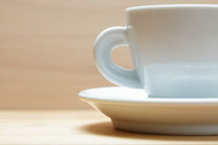 White cup on wood sideview Stock Images