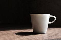 White cup on wood table Royalty Free Stock Photo