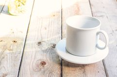White cup on wooden background Royalty Free Stock Photos
