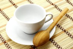 White cup with wooden spoon Stock Photos