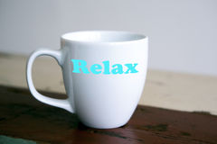 White cup with the words Relax Stock Photo