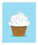 White cupcake. White icing cupcake with sprikles and polkadot background Stock Photos