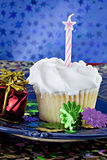 White cupcake with pink star candle Stock Photos