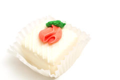 White cupcake on white. Isolated photo of a white cupcake on white Royalty Free Stock Photography