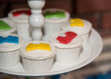 White cupcakes decorated with colored sweets Stock Photography
