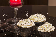 White cupcakes with silver sprinkles Stock Photos