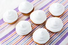 White cupcakes on the striped linen napkin top view Royalty Free Stock Photography