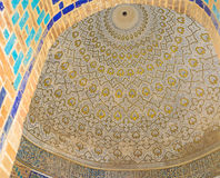 The white cupola. SAMARKAND, UZBEKISTAN - MAY 1, 2015: The cupola of the anonimus octagonal mausoleum painted in white and gilt colors, on May 1 in Samarkand royalty free stock photos