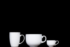 White cups in black backgrounds stock photo