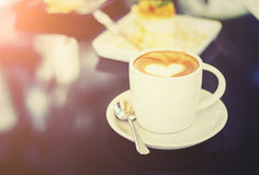 White cups of Cappuccino coffee with heart shaped milk foam. Sel Stock Photography