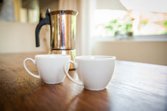 White cups and coffee plunger Royalty Free Stock Image