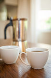 White cups and coffee plunger Stock Photo