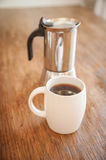 White cups and coffee plunger Stock Images