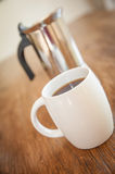 White cups and coffee plunger Stock Photography