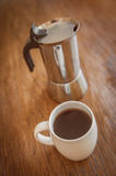 White cups and coffee plunger Stock Photos
