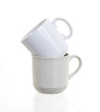 White cups isolated Stock Photography