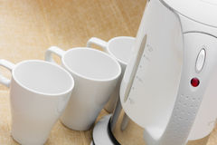 White cups and kettle Royalty Free Stock Photography