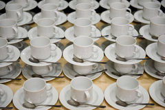White cups with saucers Stock Image