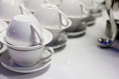White cups and saucers stock image