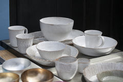 White cups and saucers Stock Images