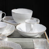 White cups and saucers Stock Photos