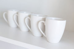 White cups on the shelf Royalty Free Stock Image