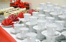 White cups stacked on a table Stock Photos
