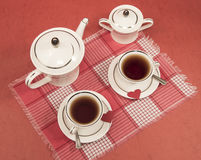 White cups, teapot, sugar bowl, red napkin, hearts VALENTINE Stock Photography