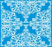 White curled decoration on blue Royalty Free Stock Photo