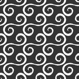White curlicues drawn with a rough brush. Black background. Seamless pattern. Stock Photos
