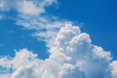 White curly clouds in a blue sky. Sky background. Stock Photos