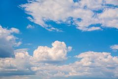 White curly clouds in a blue sky. Sky background. Royalty Free Stock Photos