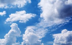 White curly clouds in a blue sky. Sky background, Stock Photo