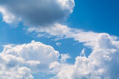 White curly clouds in a blue sky. Sky background, Royalty Free Stock Photography